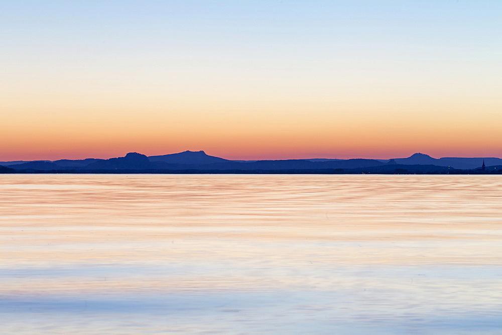 Sunset behind Hegau Volcano Hohenstoffeln, Hohentwiel, Hohenhewen, Hohenkrahen, Magdeberg and Radolfzell, Reichenau Island, Reichenau, Baden-Wurttemberg, Germany, Europe