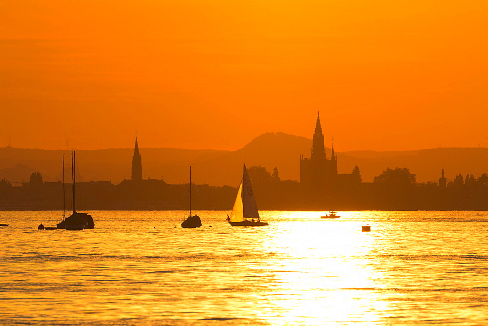 Skyline at sunset with sailboat, Lake Constance, Konstanz, Baden-Württemberg, Germany, Europe