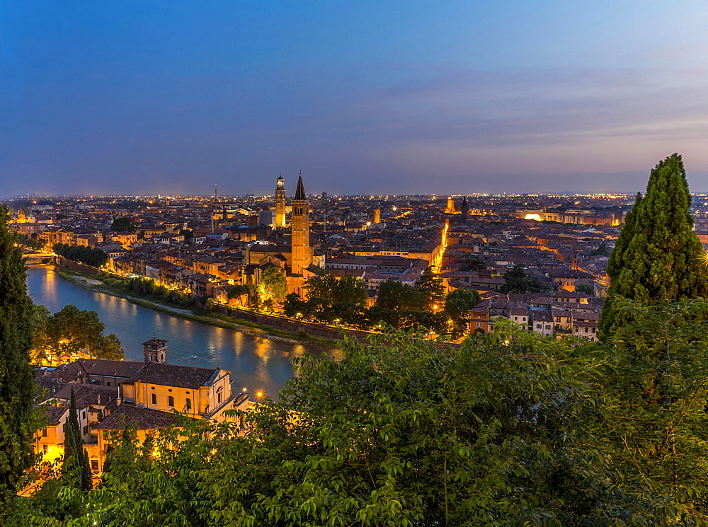 View at dusk from the hill of San Pietro to the old town, blue hour, river Adige with Roman bridge Ponte Pietra, Verona, Veneto, Italy, Europe