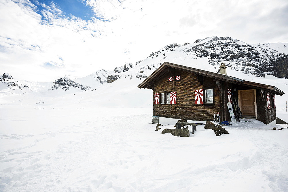 Traditional wooden chalet and snowy winter landscape, Melchsee-Frutt, Canton of Obwalden, Switzerland, Europe