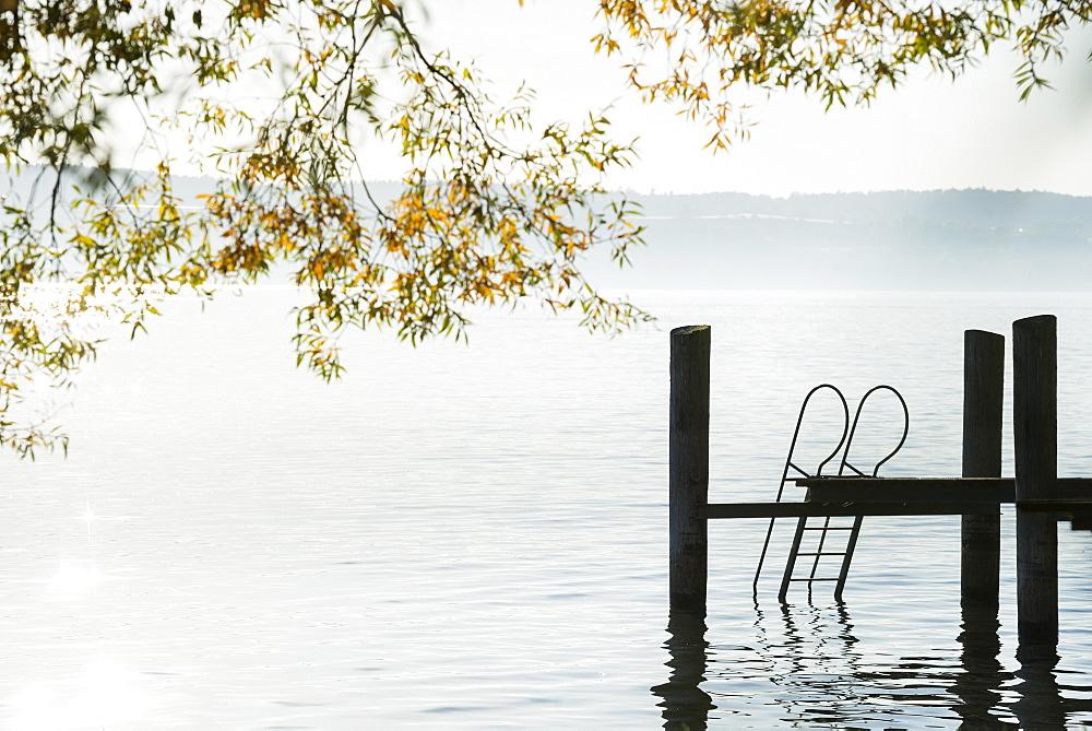 Bridge with ladder into the lake, Lake Constance in autumn, Uhldingen-Mühlhofen, Baden-Württemberg, Germany, Europe