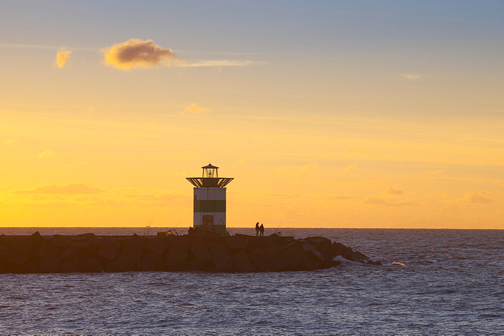 Small lighthouse at harbor entrance, sunset, Scheveningen, The Hague, Holland, The Netherlands, Europe