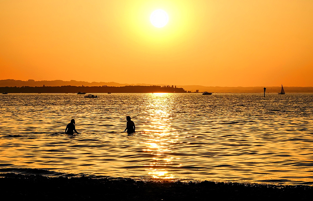 Bathers in Lake Constance, sunset, Rohrspitz, Vorarlberg, Austria, Europe