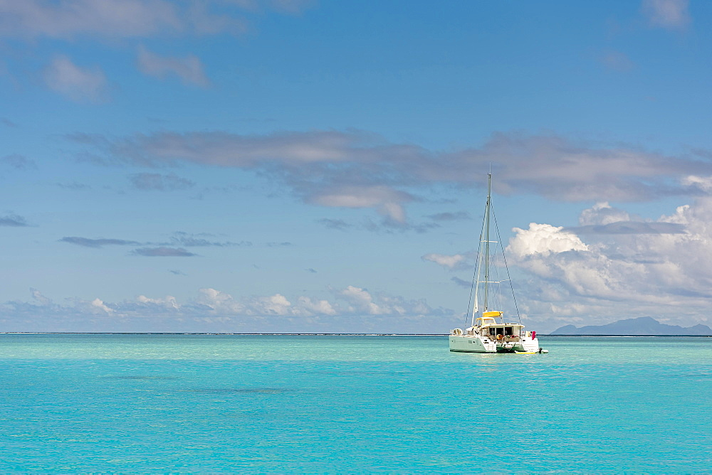 Catamaran in turquoise lagoon, Raiatea, South Pacific, French Polynesia, Oceania