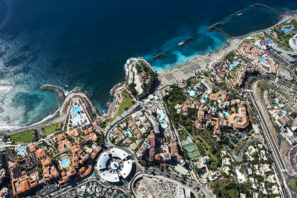 Seaside resort with beach and promenade by the sea, Playa del Duque, townscape with hotels and shopping malls, tourist area, south coast, Costa Adeje, Tenerife, Spain, Europe