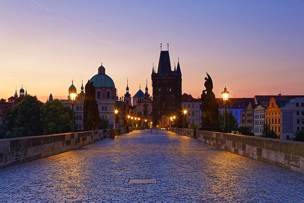 Charles Bridge, Karluv most on the Vltava River, UNESCO World Heritage Site, with Old Town Bridge Tower and Church of St. Francis Seraph, Prague, Czech Republic, Europe