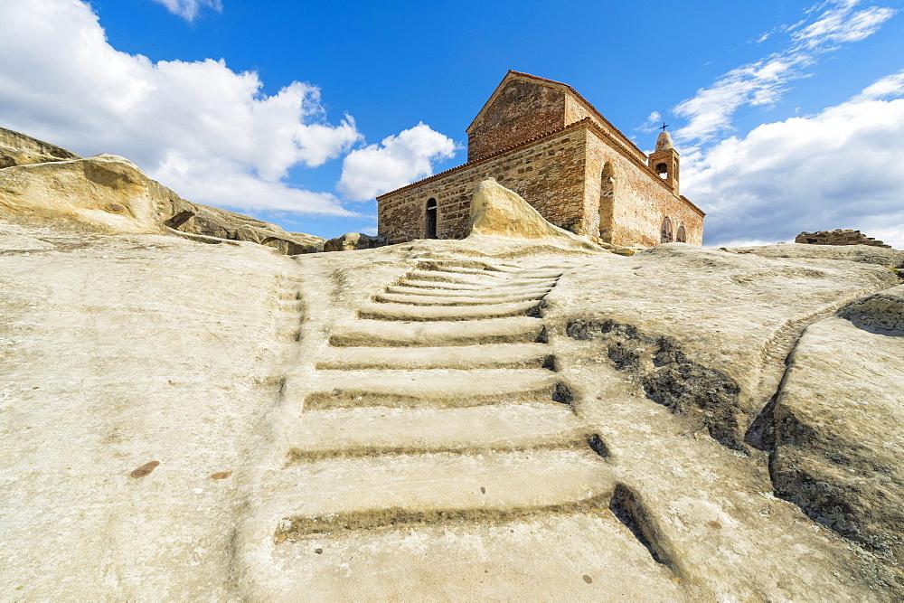 Stairs leading to 10th century Christian Prince's basilica, Uplistsikhe cave city known as Lord's fortress, Gori, Shida Kartli district, Georgia, Asia