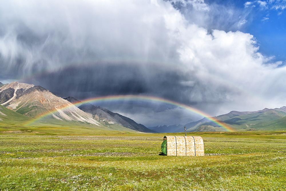 Tent under a rainbow over meadow, Naryn gorge, Naryn Region, Kyrgyzstan, Asia