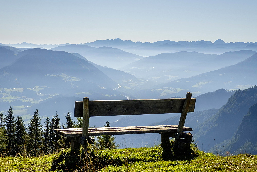 Wooden bench overlooking Schladming Tauern, Alps, Styria, Austria, Europe