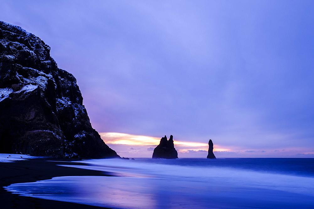 Basalt rocks Reynisdrangar near Vík í Mýrdal, Twilight, Suðurland, Southern Region, Iceland, Europe