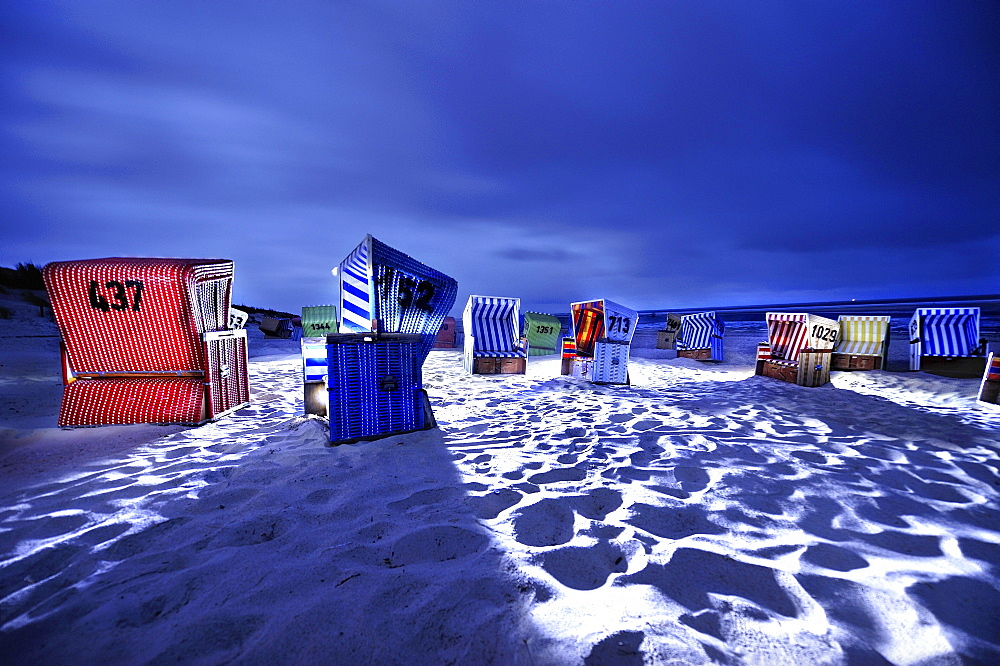 Dramatically illuminated beach chairs at night, Langeoog Beach, East Frisian Islands, Germany, Europe