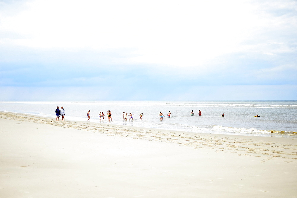 Children play and swim on the beach, Langeoog, East Frisian Islands, Germany, Europe