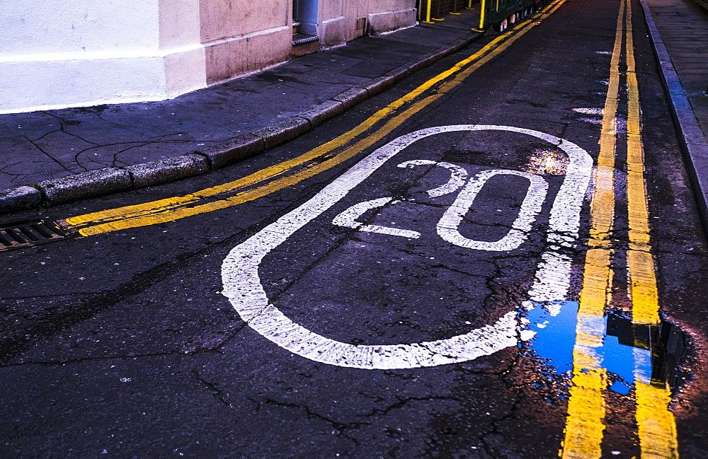 Marking on road lane, speed limit, London, Great Britain