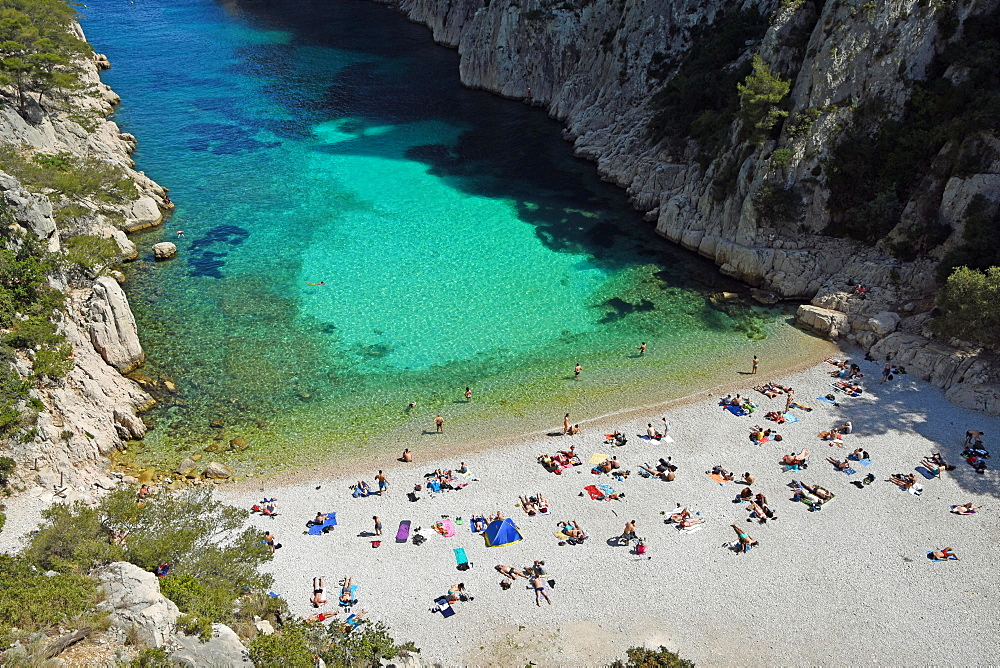 Tourists at beach with turquoise water, Calanque d'en Vau, Calanques National Park, Provence, France, Europe