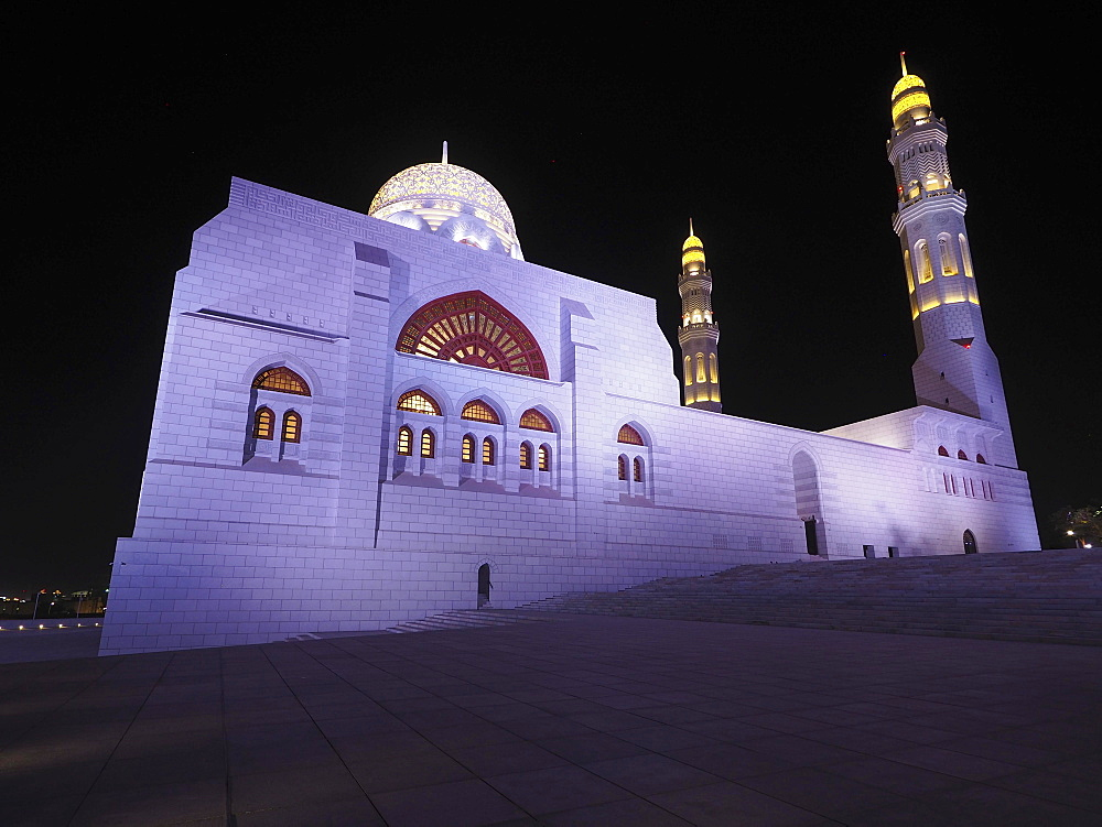Night view of the Mohammed Al Ameen Mosque with minaret, illuminated, Muscat, Oman, Asia