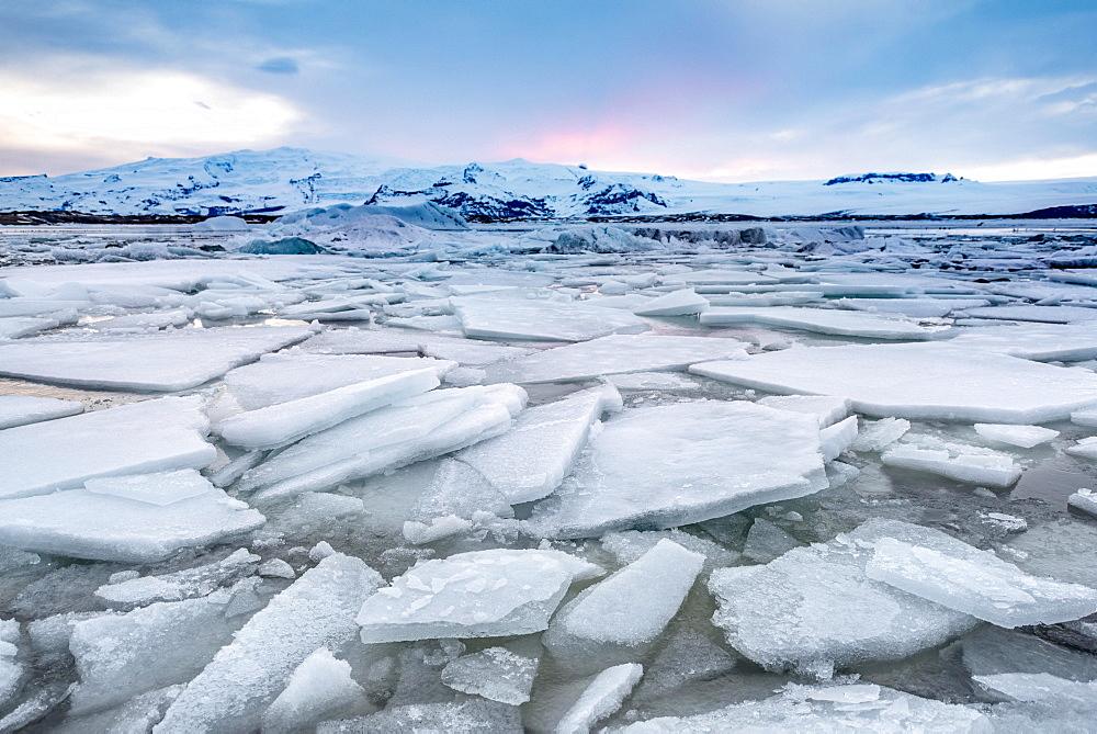 Ice floes, glacier Jokulsarlon lagoon, glacier lake, sunset, southern edge of Vatnajokull, southeast Iceland