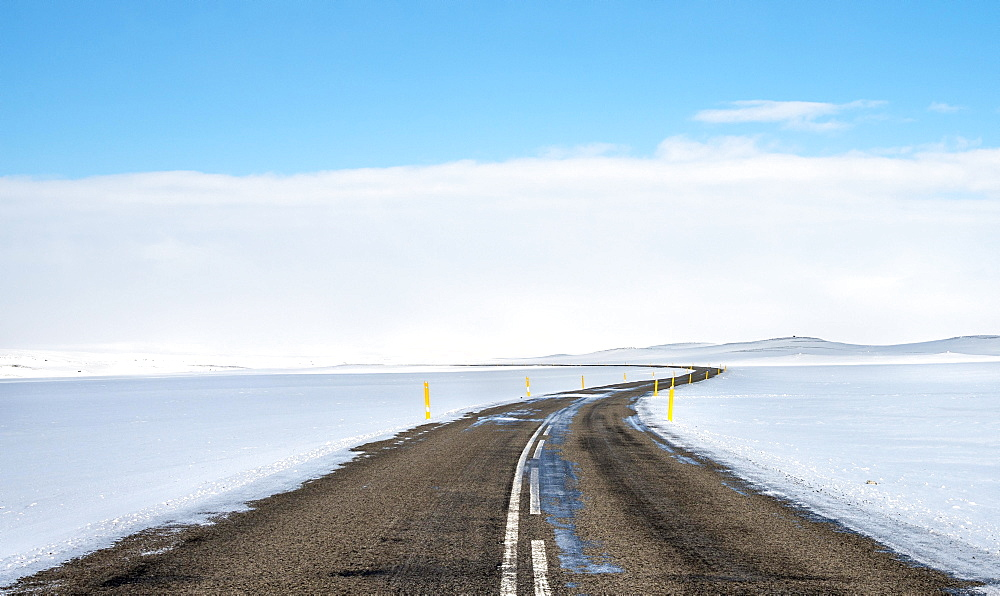 Road through snowy landscape, Route 1 between Eglstadir and Myvatn, Norourland eystra, Northern Iceland, Iceland, Europe