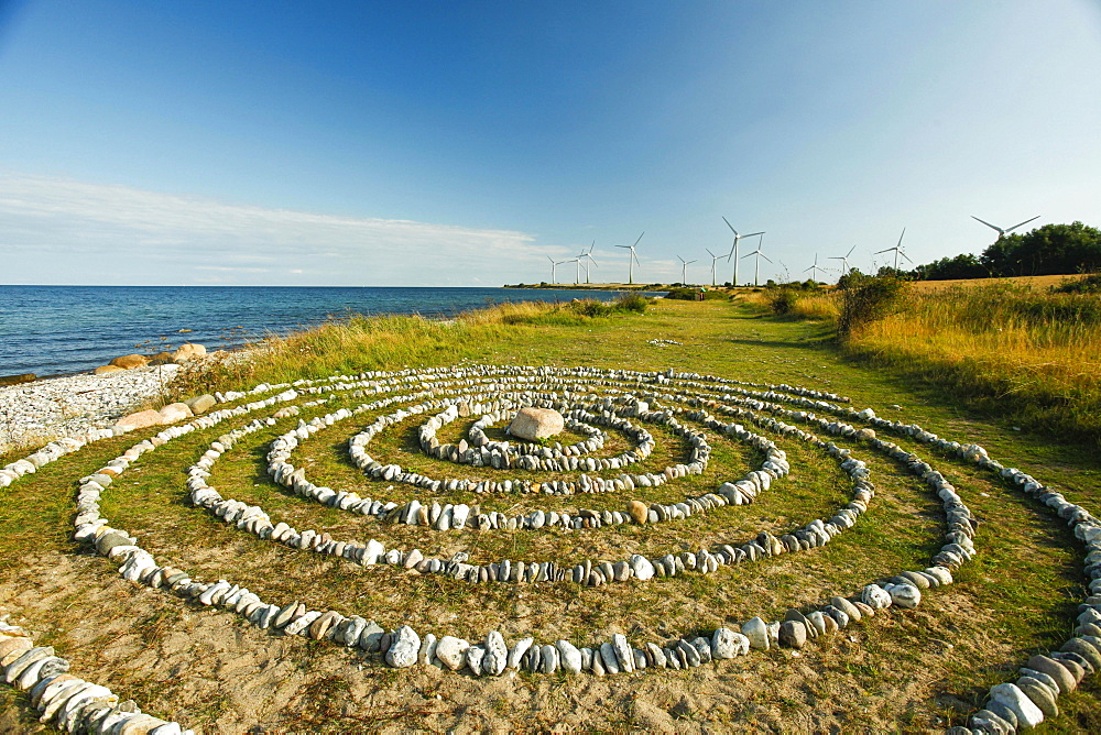 Stone circles and wind farm on the Baltic Sea coast, near Klausdorf, Fehmarn Island, Schleswig-Holstein, Germany, Europe