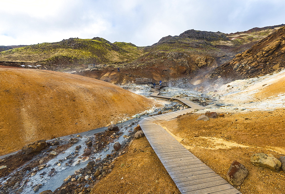 Boardwalk over steaming ground, mineral deposits, Seltun geothermal area, Krysuvik volcanic system, Reykjanesfolkvangur conservation area, Iceland, Europe