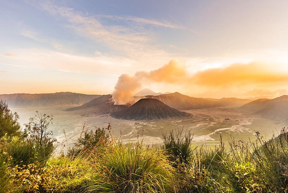 Sunrise, smoking volcano, Gunung Bromo, Mount Batok, Mount Kursi, Mount Semeru, Bromo Tengger Semeru National Park, Java, Indonesia, Asia