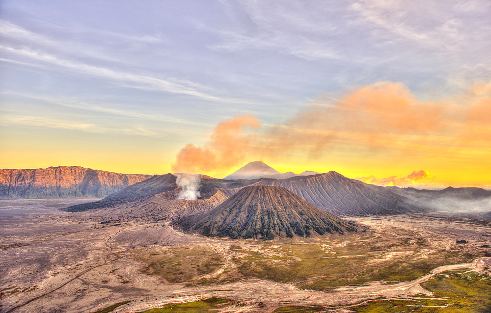 Sunset, smoking volcano Gunung Bromo, Mount Batok in front, Mount Kursi at back, Mount Gunung Semeru, Bromo Tengger Semeru National Park, Java, Indonesia, Asia