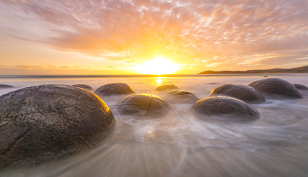 Moeraki boulders, at sunrise, geological formation, Koekohe Beach, Moeraki, East Coast, Otago, South Island, New Zealand, Oceania