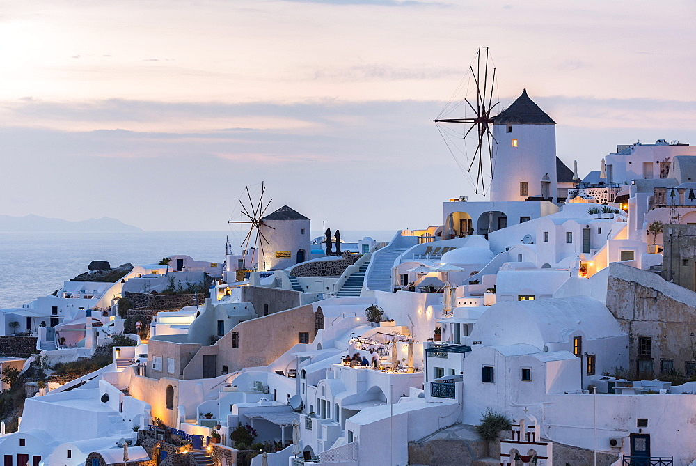 Townscape with windmills, dusk, Oia, Santorini, Cyclades, Greece, Europe