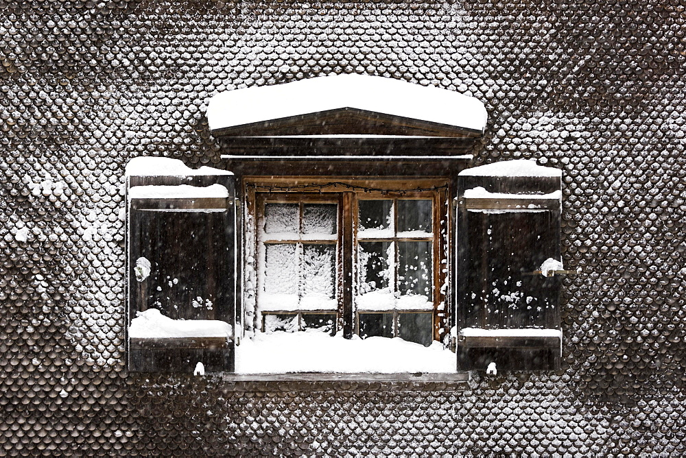 Snow-covered window on old farmhouse, Hittisau, Bregenz Forest, Vorarlberg, Austria, Europe