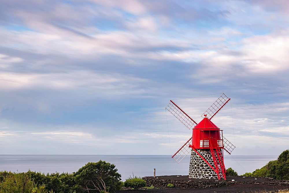 Red windmill in front of a cloudy sky, island of Pico, Azores, Portugal, Europe