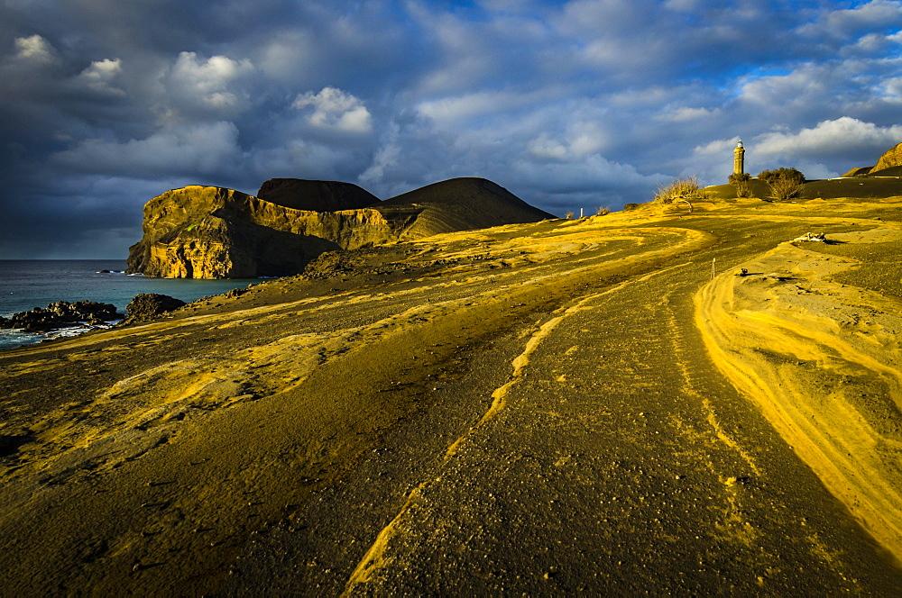Rocky coast with lighthouse Farol da Ponta dos Capelinhos, Capelinhos peninsula, island of Faial, Azores, Portugal, Europe