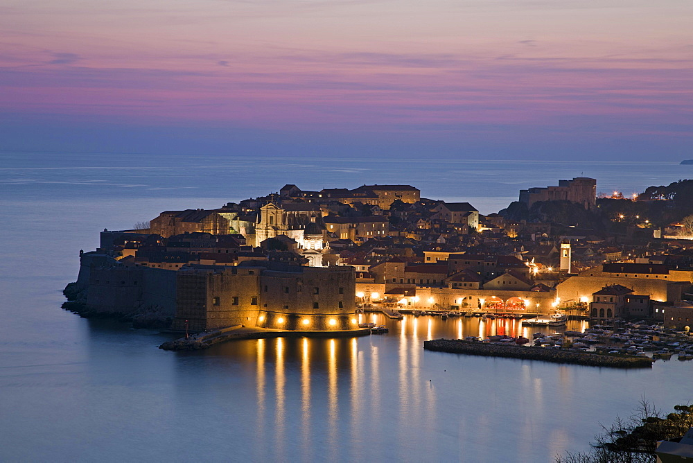 Panoramic view of the illuminated old town, dusk, Dubrovnik, Croatia, Europe
