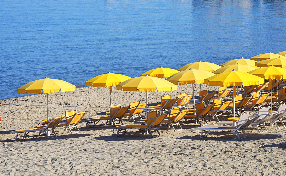 Town beach with yellow parasols, Cefalu, Sicily, Italy, Europe