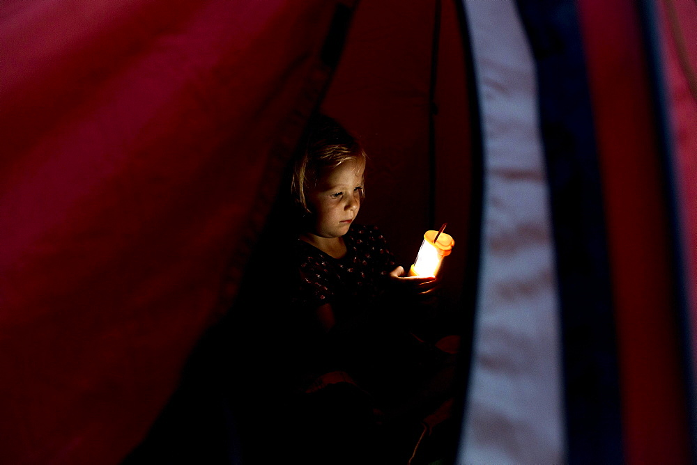 Toddler, three years old, in tent with torch, Germany, Europe