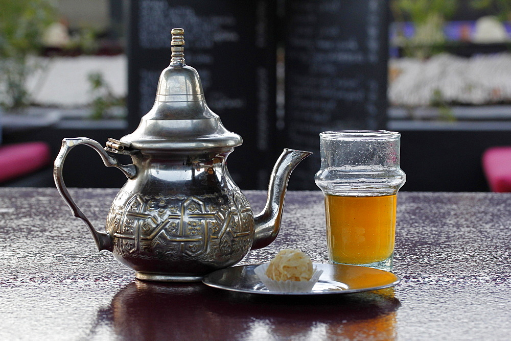 Moroccan silver teapot, glass of mint tea, Marrakesh, Morocco, Africa