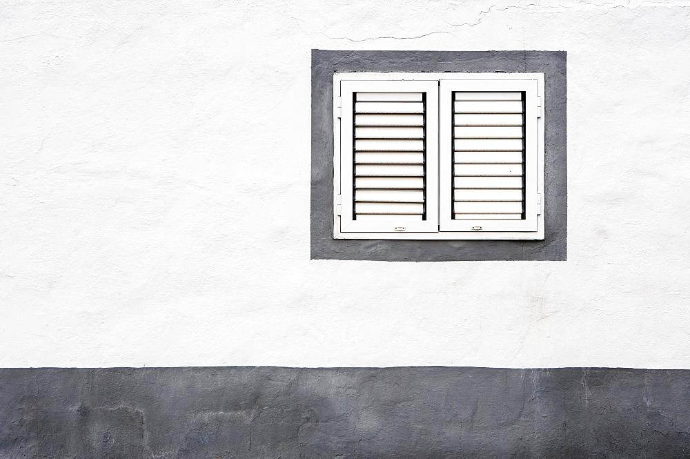 White House facade with closed windows, Ajuy, Fuerteventura, Canary Island, Spain, Europe - 832-381036