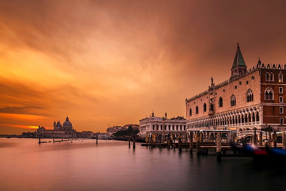 Doge's Palace, St Mark's Square, behind Santa Maria della Salute at sunset, Venice, Veneto, Italy, Europe