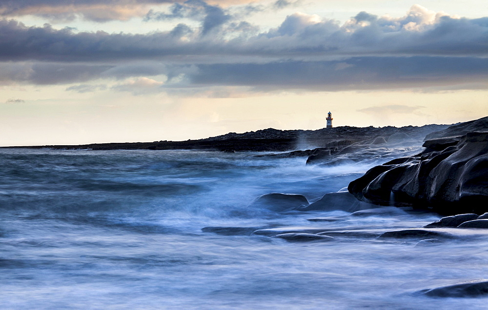 Lighthouse by the coast, high tide, Inis Oirr, Aran Islands, Ireland, Europe