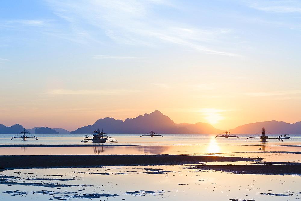 Sunset view from Corong Corong beach near El Nido, Bacuit archipelago, Palawan island, Philippines, Asia