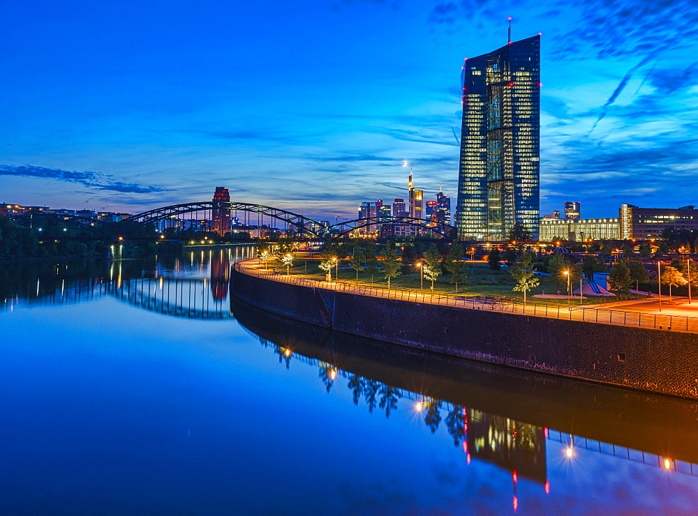 European Central Bank, ECB, at dusk in front of the illuminated skyline, roundabout at the Osthafen bridge, Frankfurt am Main, Hesse, Germany, Europe