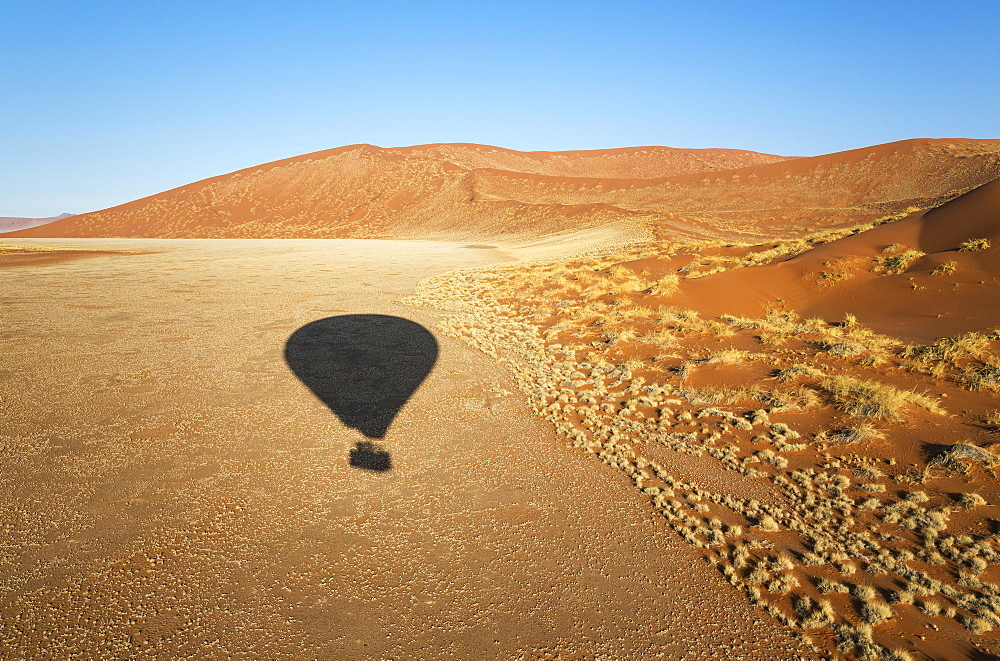 Shadow of a hot-air balloon in the Namib Desert, photographed from the basket of the balloon, Namib-Naukluft National Park, Namibia, Africa