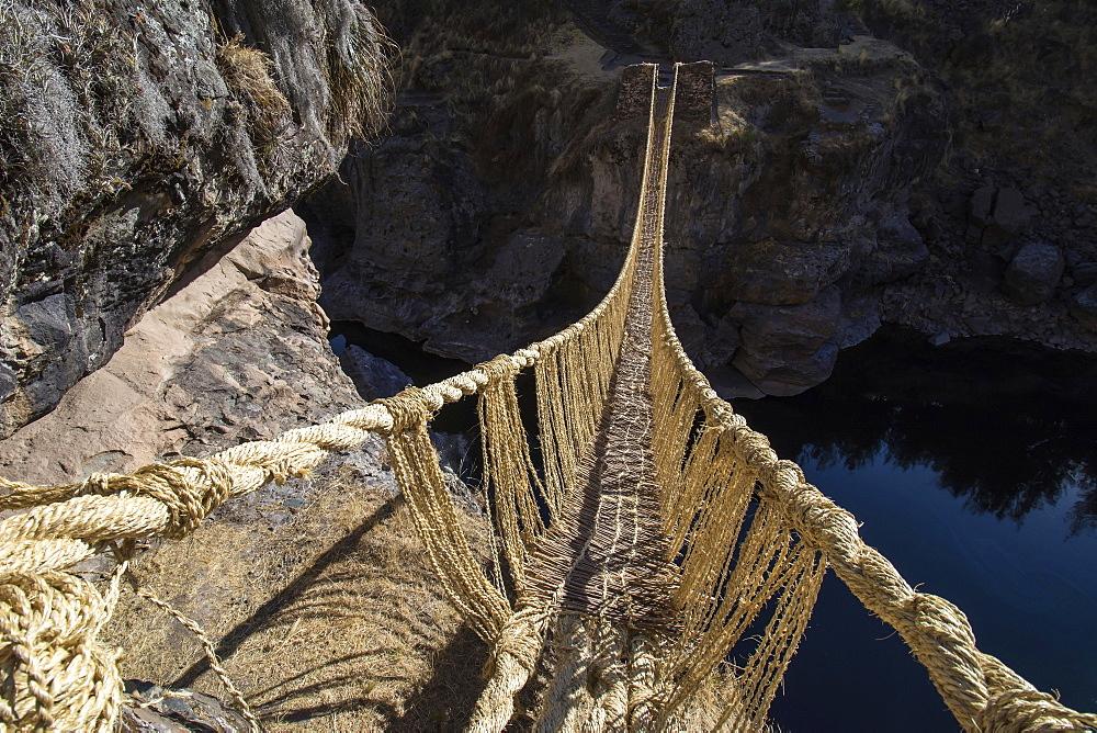 Last intact Inca rope bridge made of braided Peruvian feathergrass (Jarava ichu), across River Apurimac, Peru, South America
