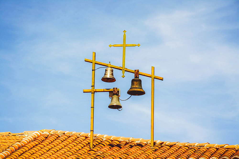 Bells and Crosses on the roof of a church, Haute-Loire department, Auvergne, France, Europe