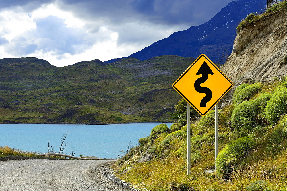 Road Sign Attention curves at Lago Pehoe, Torres del Paine National Park, Última Esperanza Province, Chile, South America