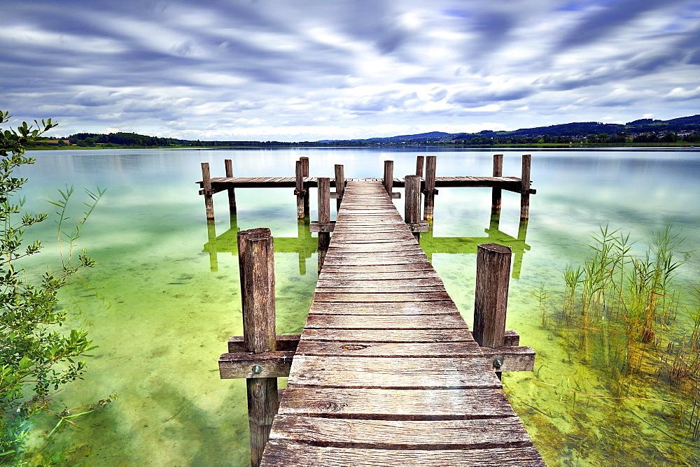 Wooden pier at Pfäffikersee, cloudy sky, Pfäffikon, Canton of Zurich, Switzerland, Europe