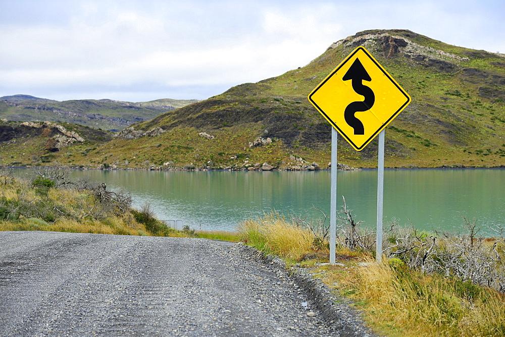 Sign Attention curves along the natural road, Laguna Amarga, Torres del Paine National Park, Última Esperanza Province, Chile, South America