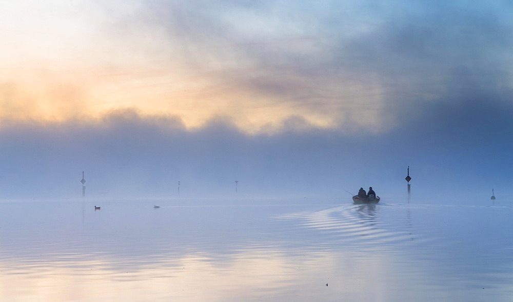 Fishing boat on the mist-shrouded Untersee, Radolfzell, Baden-Wurttemberg, Germany, Europe