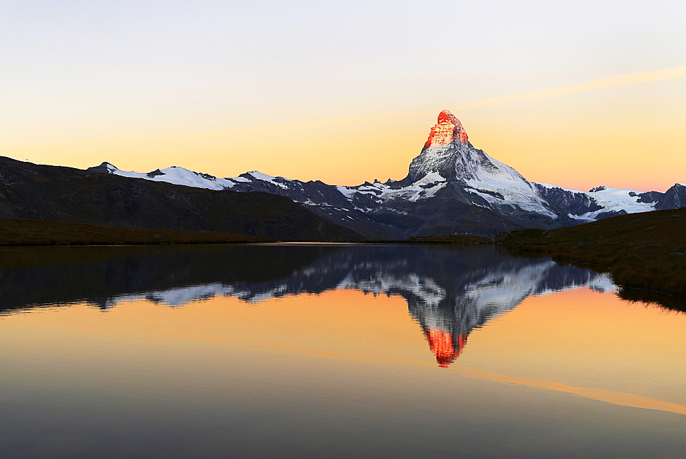 Matterhorn reflected in lake Stellisee, at sunrise, Valais Alps, Canton of Valais, Zermatt, Switzerland, Europe
