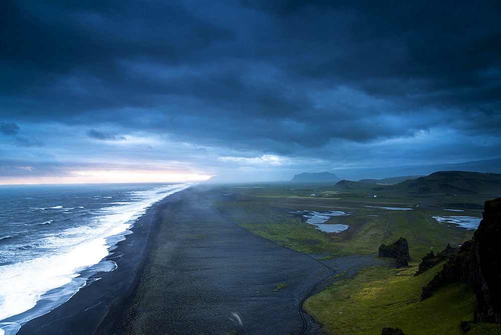 Dramatic clouds, black sandy beach near Dyrholaey, south coast, Southern Region, Iceland, Europe