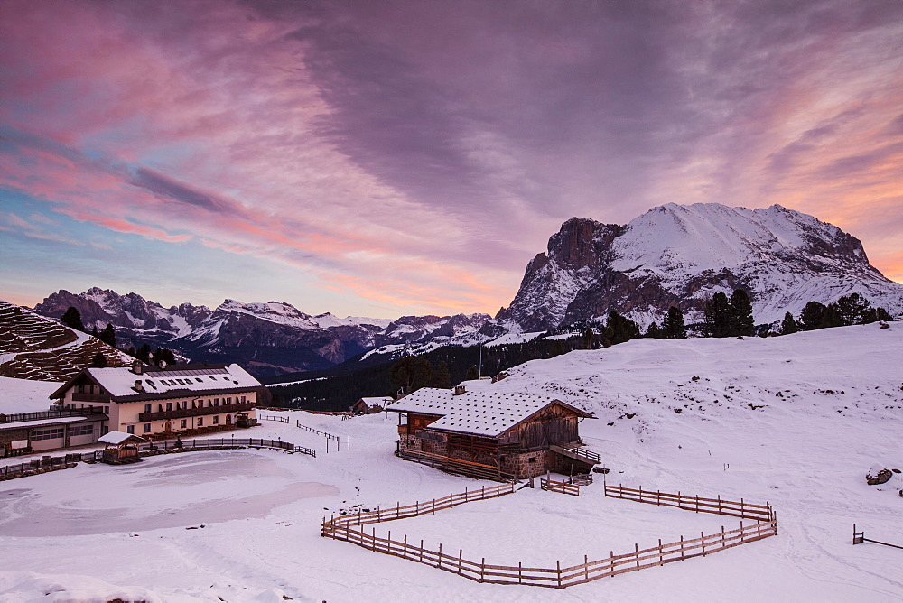 Dawn on Plattkofel and Mahlknechthutte hut in winter, Saltria, Province of South Tyrol, Italy, Europe