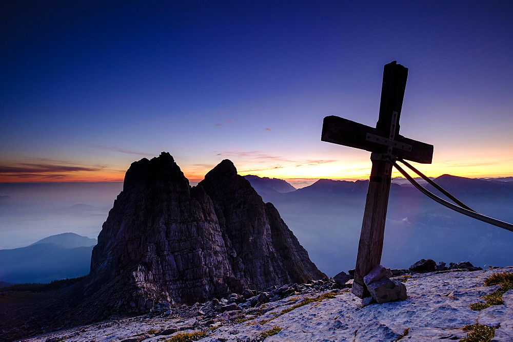 Summit cross of the third Watzmannkind in front of first and second Watzmannkind, morning mood, Watzmannkar, Watzmann, Berchtesgaden National Park, Berchtesgaden Alps, Schonau am Konigsee, Bavaria, Germany, Europe